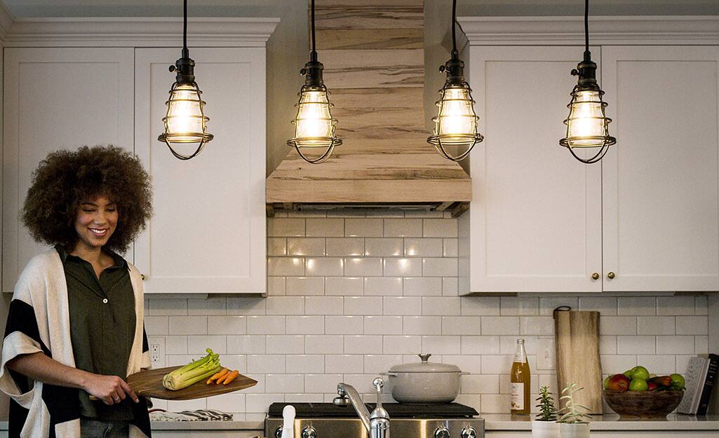 New industrial-style pendant lighting in a kitchen.