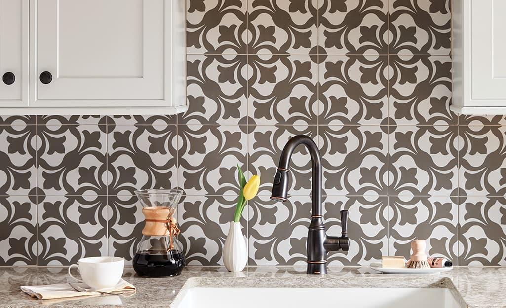 A pattern backsplash in a kitchen.