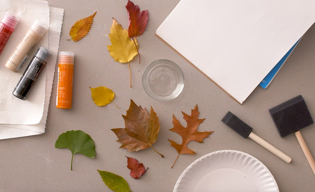 Leaves, paint, paint brushes and other supplies.