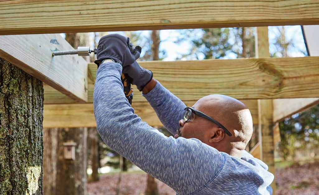 Joists are attached to deck boards.