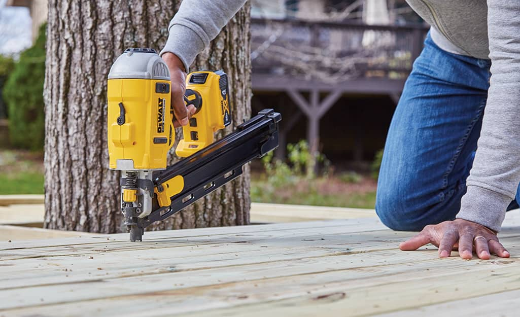 A nailer is used to attach deck boards to a platform.