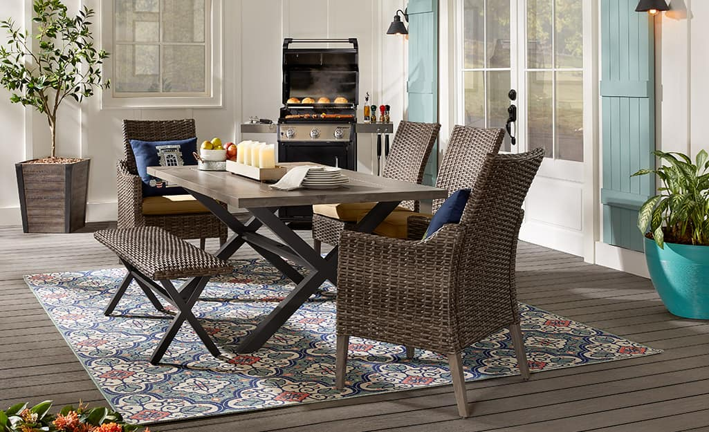 Brown dining table and chairs on patio