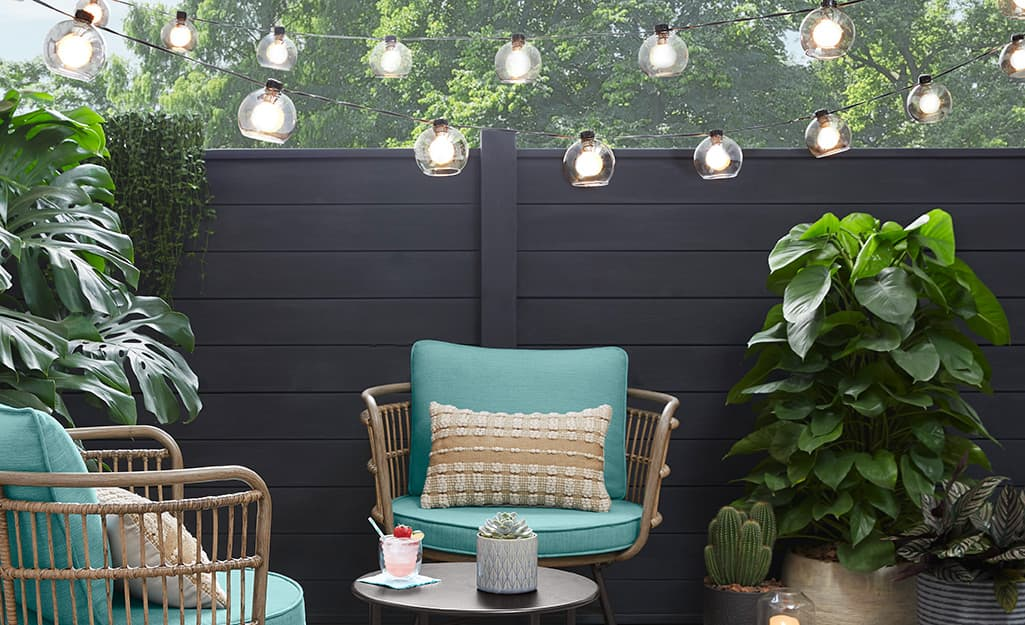 String lights over outdoor chairs on a patio