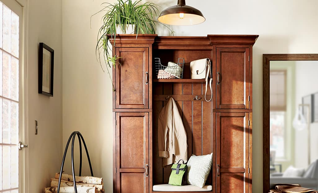 A wood cabinet with houseplants