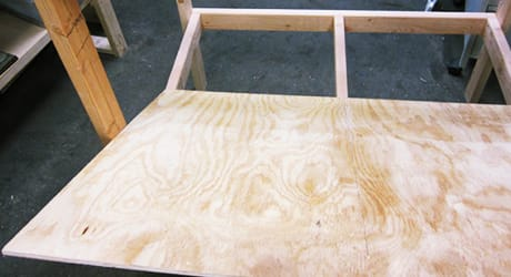 A wood floor placed in the bottom of a chicken coop.
