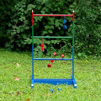 A DIY ladder golf game displayed in a yard.