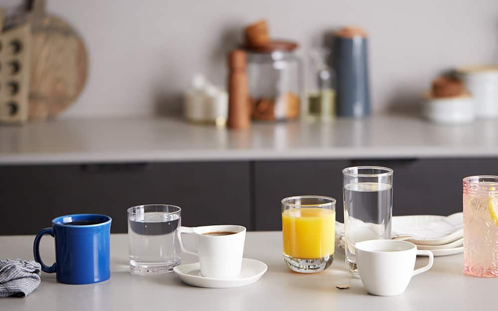 An assortment of drinking glasses on a table.