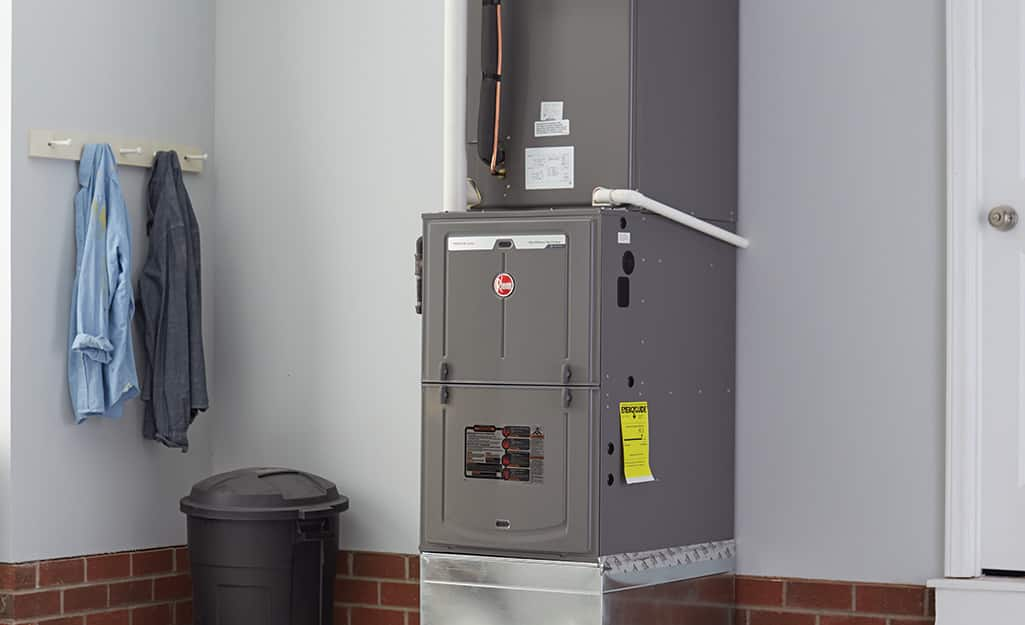 A furnace in a utility space of a home.
