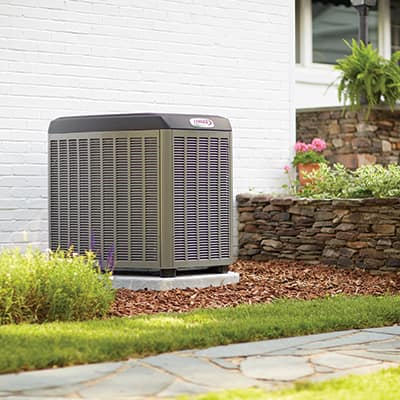 An air conditioner sitting outside a home.