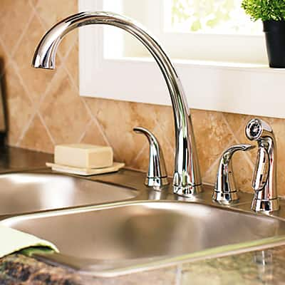 A fully installed 2-handle kitchen faucet.