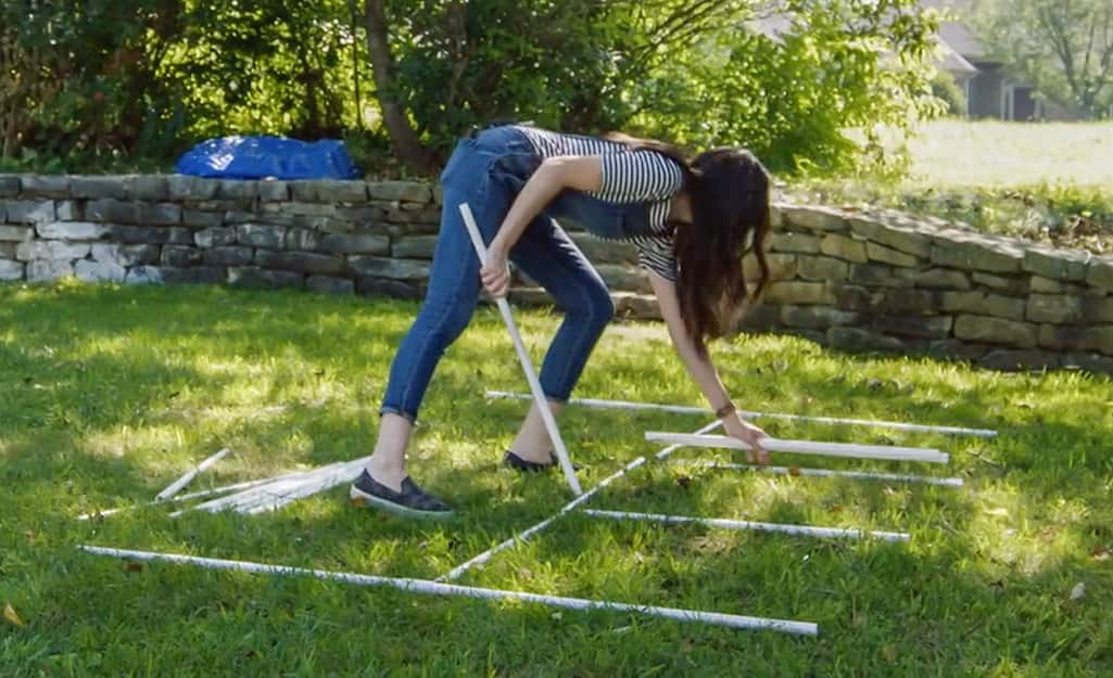 A person laying out a design for a DIY Kids Sprinkler.