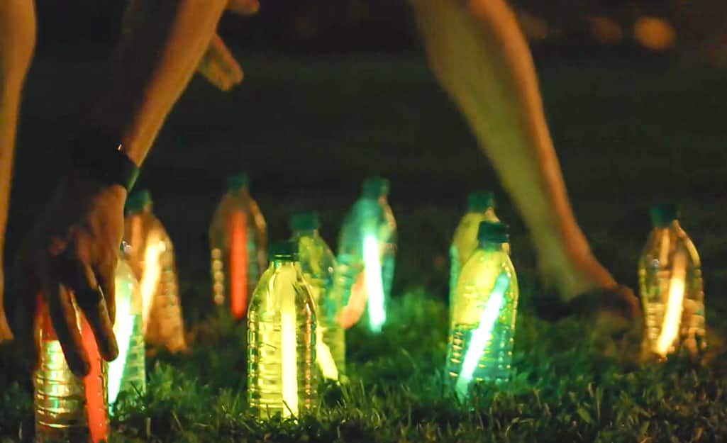 Water bottles filled with glow sticks.
