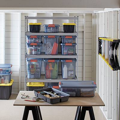 A well-organized basement with shelving.