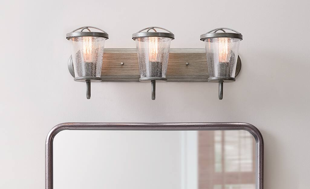 Lighting fixture above a mirror.