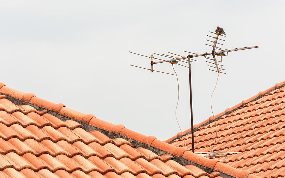 Old antenna on a roof.