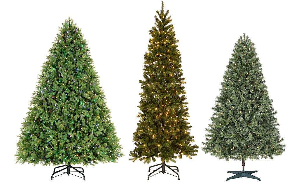 Three artificial Christmas trees in full, slim and medium widths.