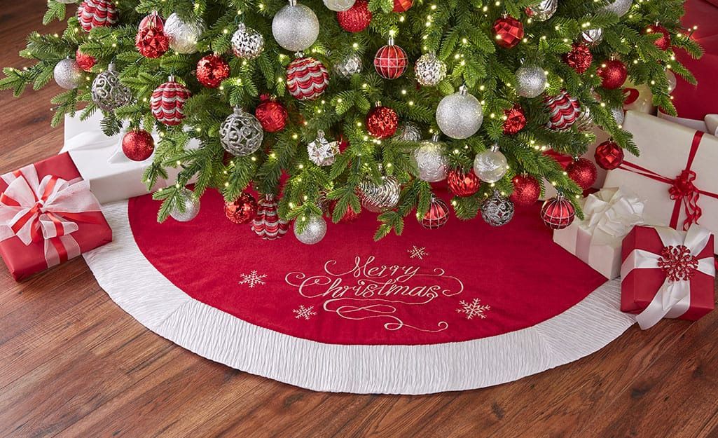 A red and white Christmas tree skirt.
