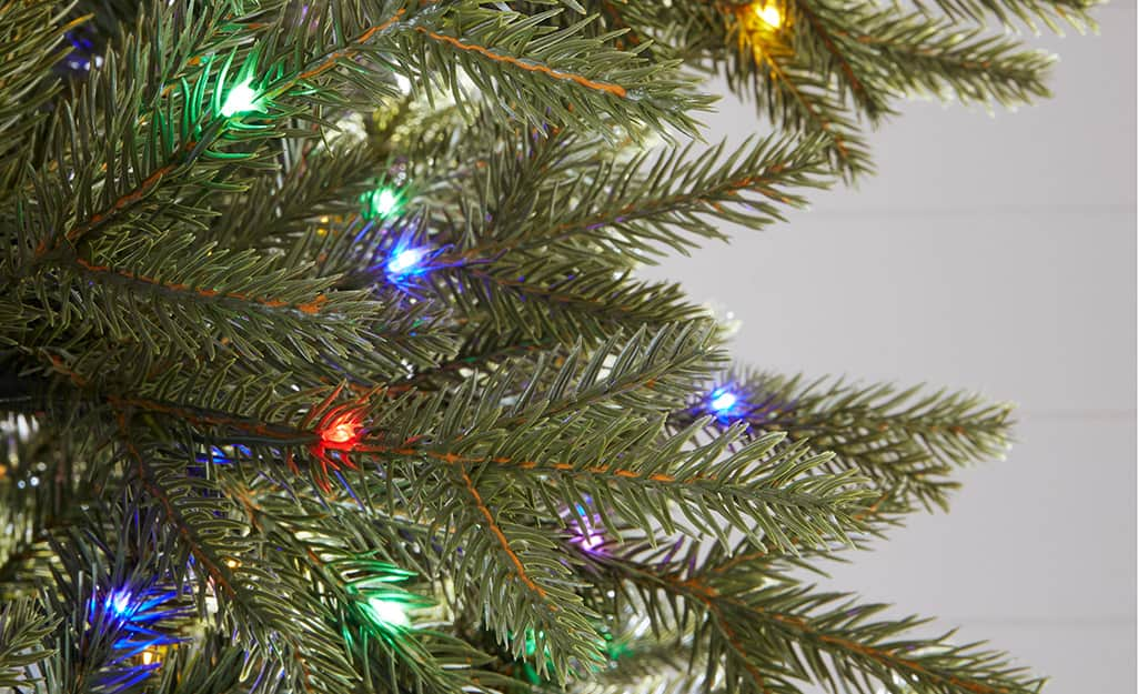 A close up of a pre-lit artificial Christmas tree.