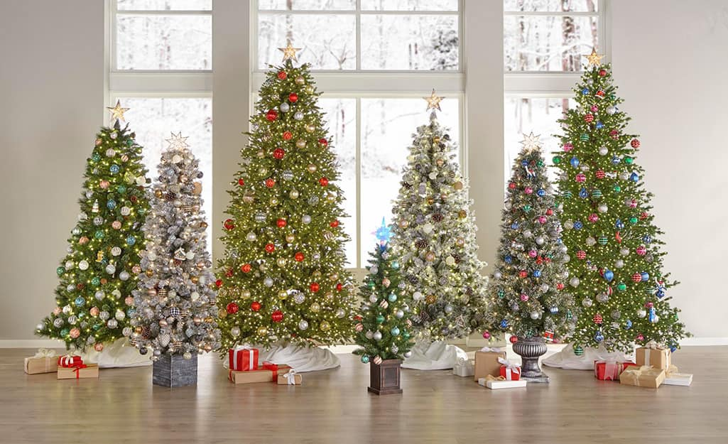 An array of artificial Christmas trees in a row.