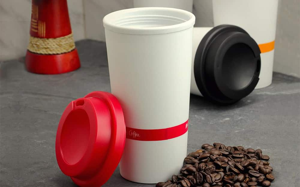 open white and red reusable coffee cup with a silicone ring
