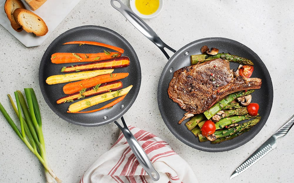 Two skillets containing food from a titanium cookware set