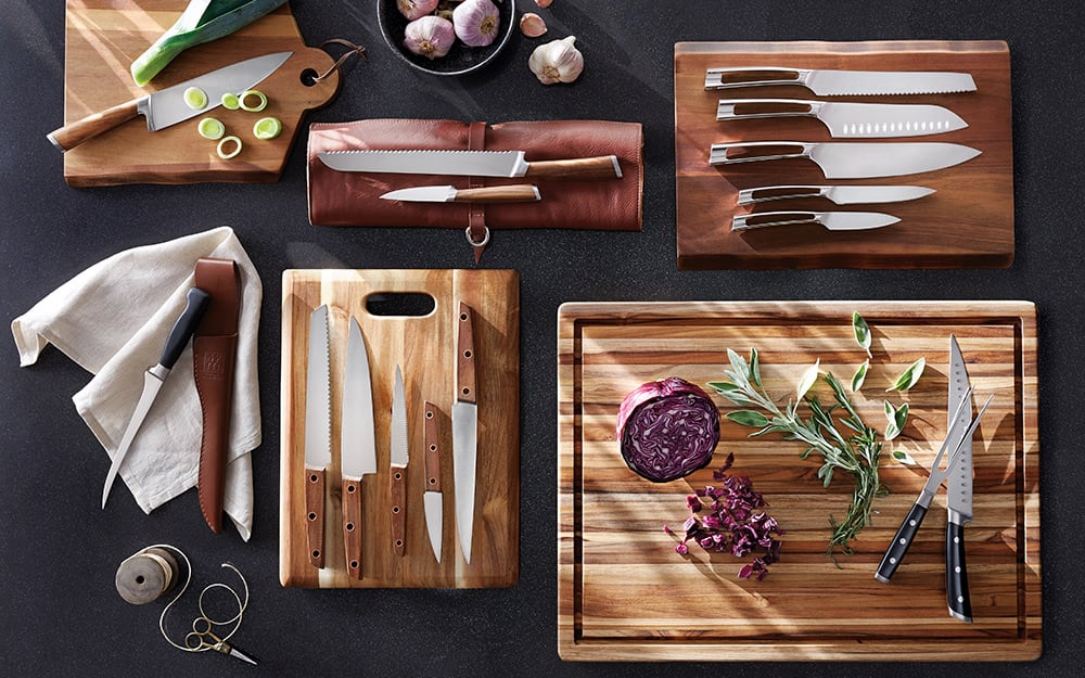 Wood cutting boards with knives.