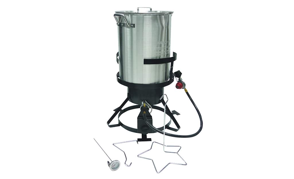 An outdoor deep fryer with a lid, lifting tool and removable thermometer.
