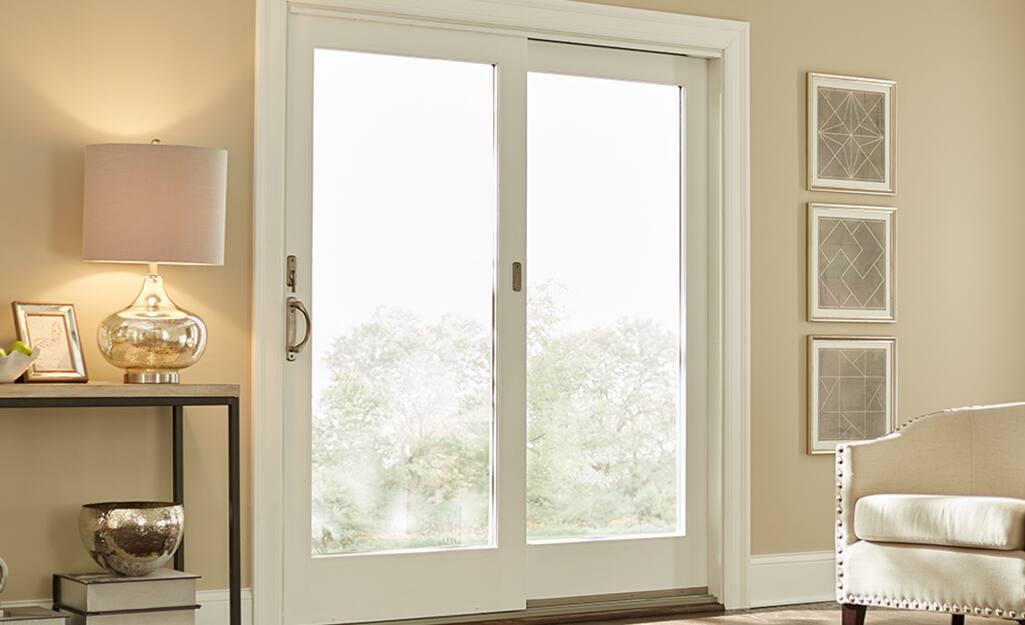 A sliding patio door in a white living room.
