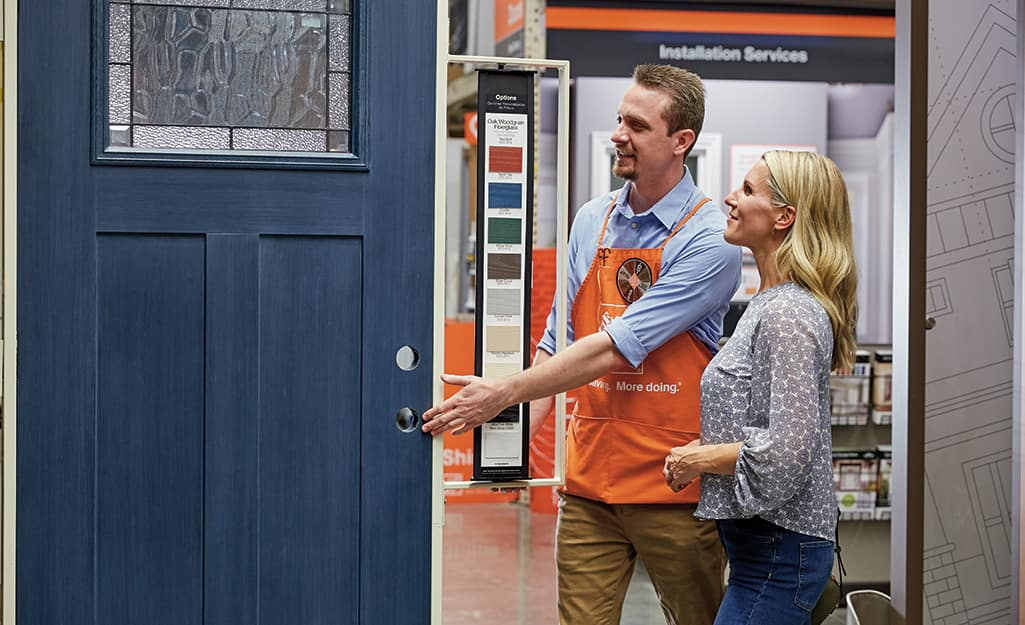 A person discussing a door order with a The Home Depot Associate.