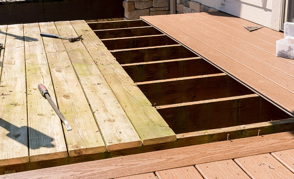 New boards are installed in a deck.
