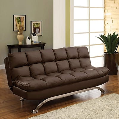 A brown leather futon in a living room.
