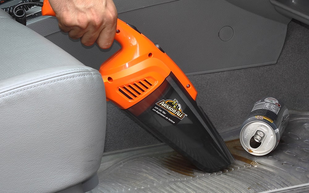 wet dry handheld vacuum cleaning spilled soda in car