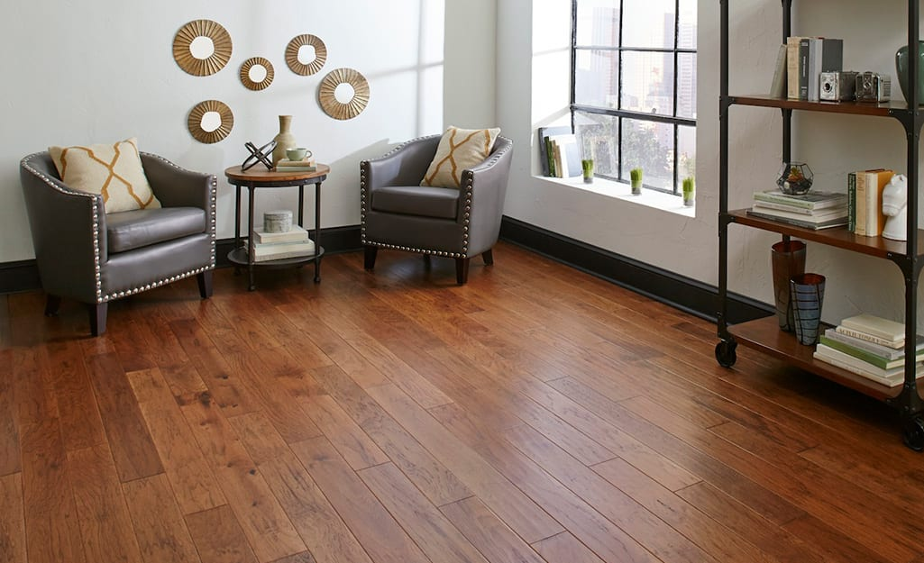 A living room with solid hardwood flooring.