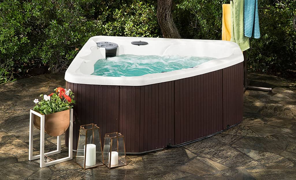 A hot tub shaped to fit into a corner.