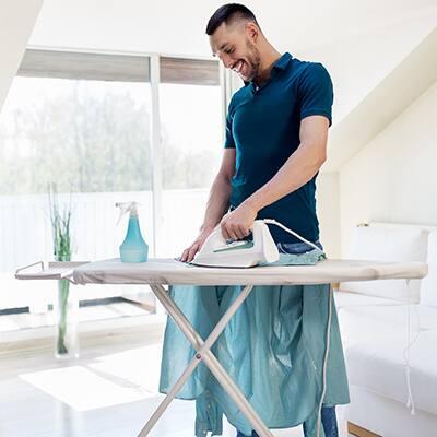 A man ironing a shirt.