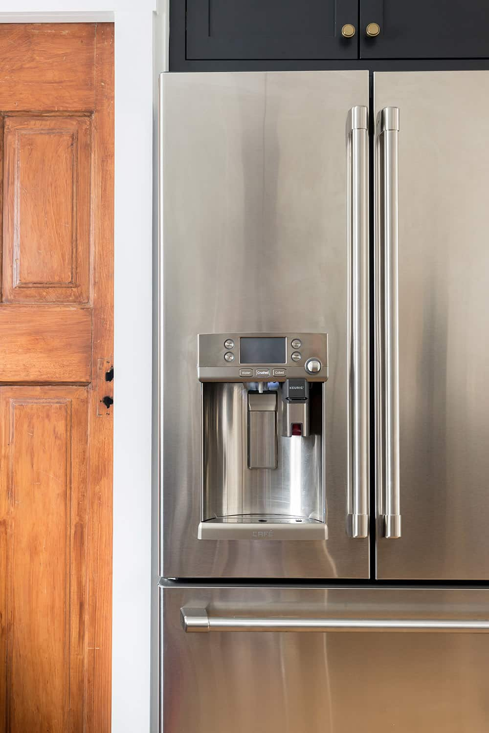 The front of a GE Cafe series stainless steel refrigerator.