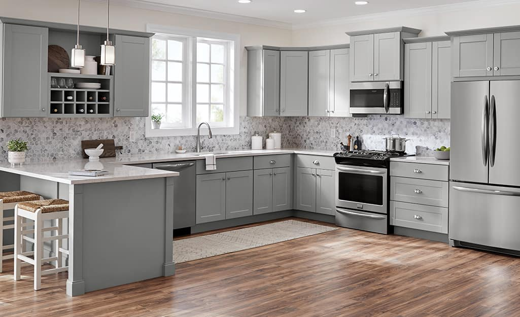 A kitchen with light gray custom cabinetry.