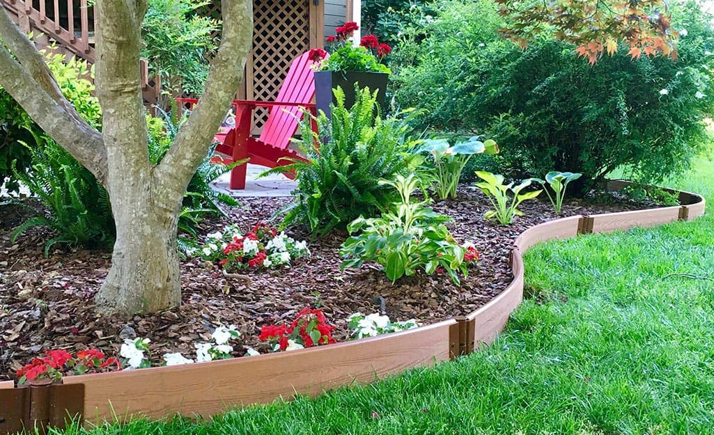 Landscape edging installed between a garden bed and lawn.