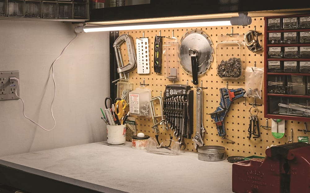 A shop light over a garage work space.