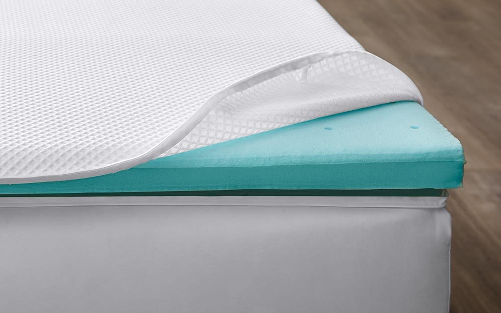 Mattress pad showing a layer of memory foam.
