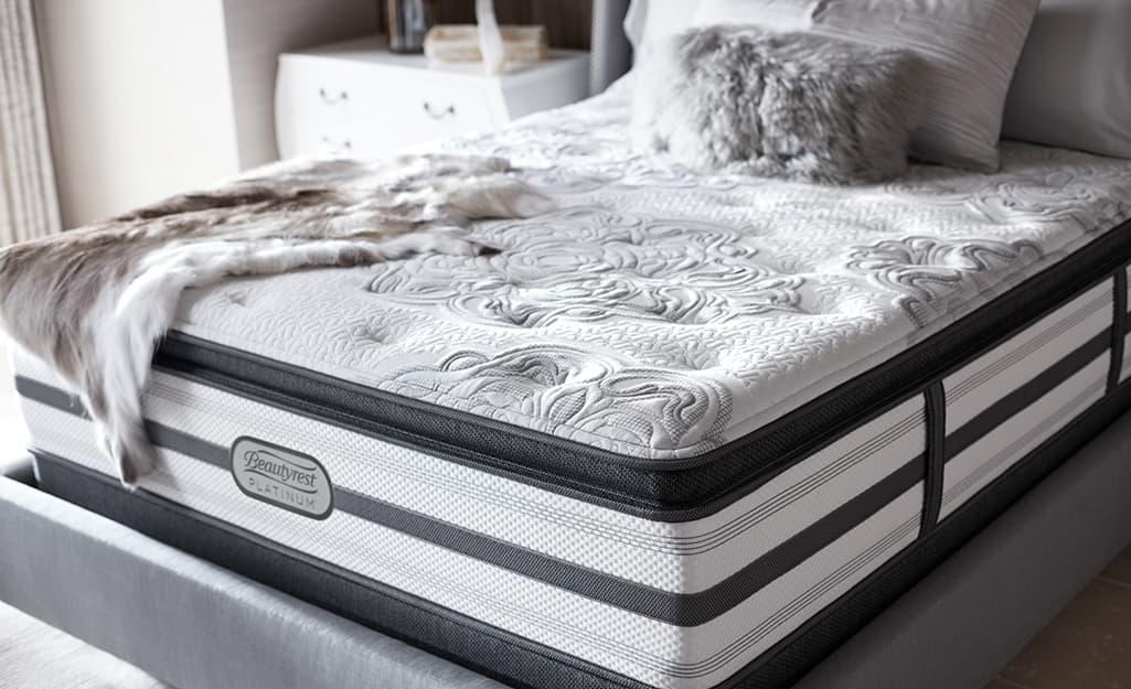 An innerspring mattress with an attached pillow top.