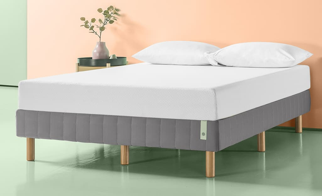 A mattress on top of a boxspring.