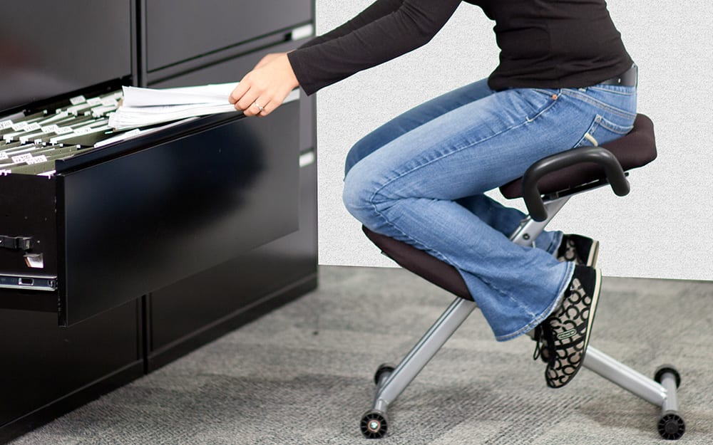 person using a kneeling chair