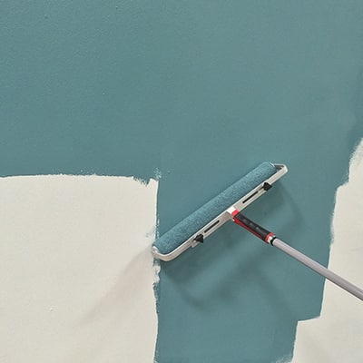 A paint roller used to apply paint on a wall.
