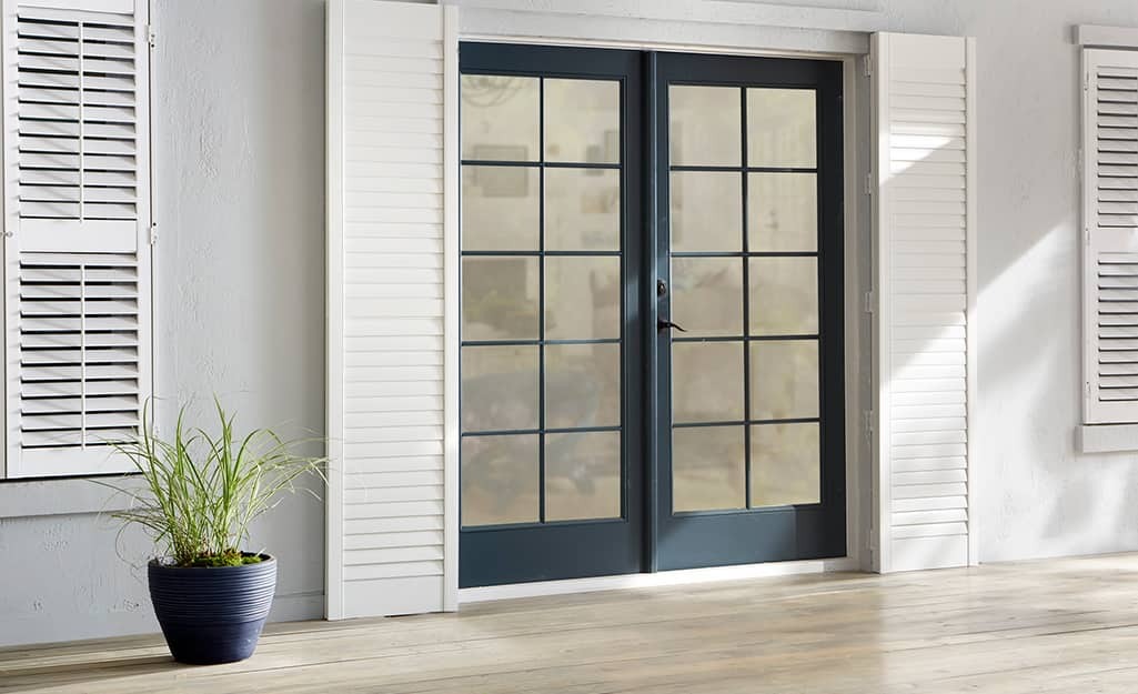 A patio door with a black frame.