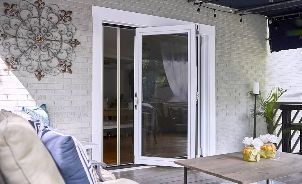 A fiberglass patio door with white trim.