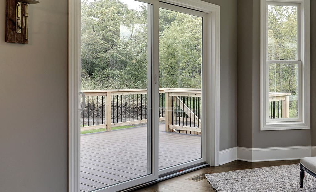 A gliding patio door leading to a deck.