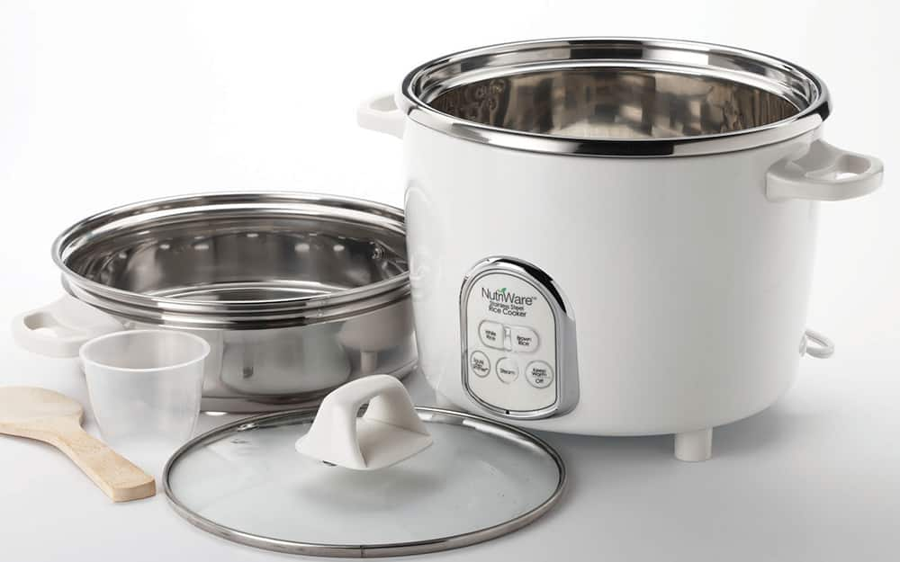 A rice cooker with various cooking utensils