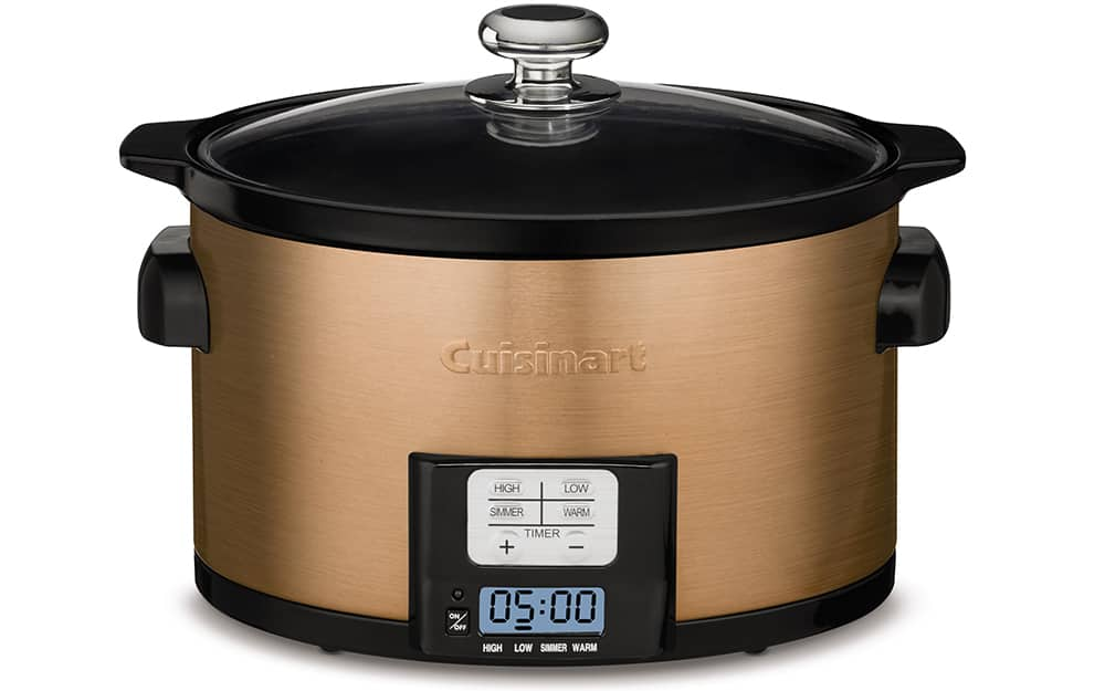 A gold slow cooker on a white background.