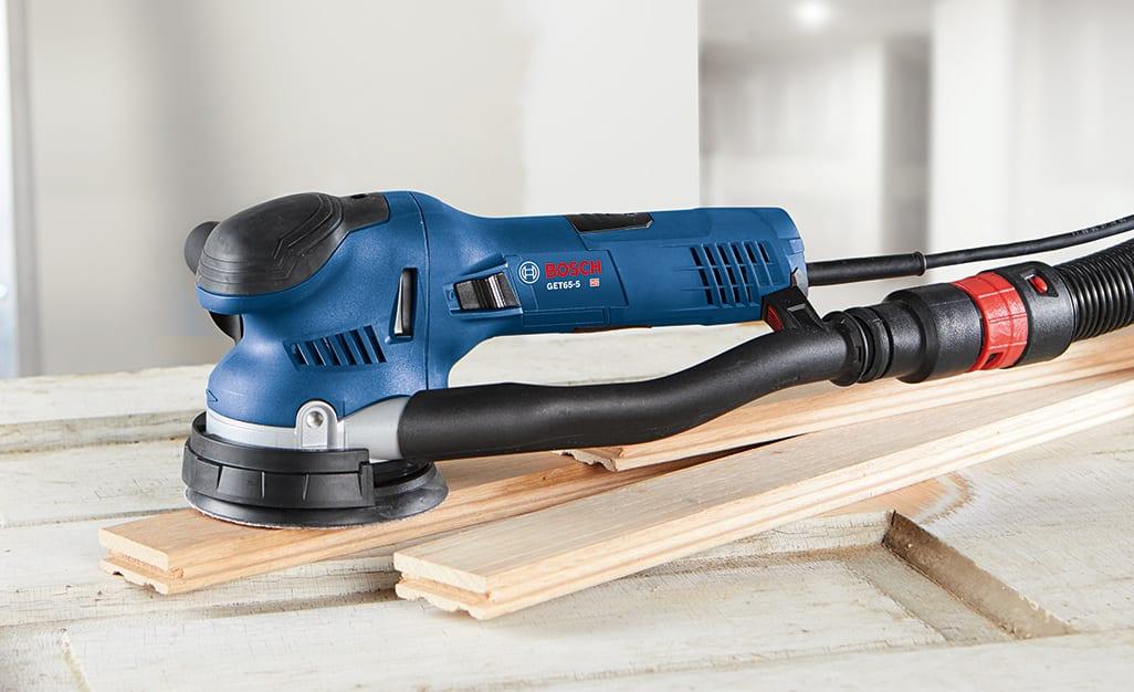 A sander is used on wood.